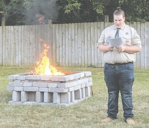 For his Eagle Scout project, Alexander Sanders assembled a team, raised money and oversaw the construction of a flag retirement pit at the Swartz Creek VFW/AMVETS Post.
