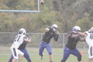 Dustin Fletcher, shown here airing it out against Lapeer last season, is considered one of the best quarterbacks in the Saginaw Valley League. Photo by Joe Oster