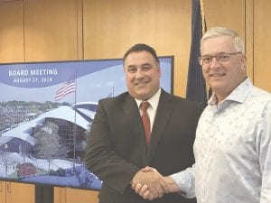 Nino Sapone, left, with Win Cooper, chairman of the Bishop International Airport Authority Board.