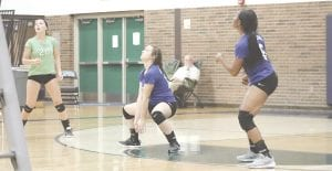 Carman-Ainsworth's Sarah Roe positions herself under a ball during a match last season. Photo by Kylee Richardson