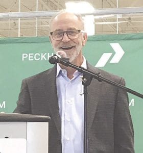 Peckham Inc. President and CEO Mitch Tomlinson welcomes about 100 visitors to an open house Sept. 5 for Peckham's new manufacturing facility in Flint Township. The plant eventually will employ up to 200 workers with disabilities. Photos by Jalene Jameson