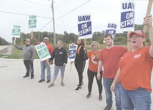 This group of GM employees was picketing Monday on the Genesee Road side of the new General Motors Distribution Center that opened just last month in Burton, on Davison Road at Genesee Road. Photo by Jalene Jameson