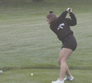 Carman-Ainsworth's Michaela Hitchcock hits her tee shot during the Davison Invitational on September 9. Photo by Brandon Pope