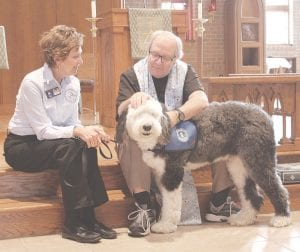 Rev. Don Davidson gives a blessing to this therapy dog at his church on Oct. 5 Photos by Gary Gould
