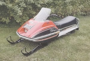 This is the restored 1978 Scorpion Snowmobile being auctioned at the event. Photos provided