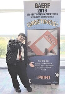 Trenton Warner, a senior at Bendle High School and a visual communications student at Genesee Career Institute, poses with a sign depicting his winning entry in the 2019 Graphic Arts Education and Research Foundation Student Design Competition during the 2019 Print Conference in Chicago. His greeting card design incorporated bubble wrap as a stress reliever. Photos provided by Genesee Career Institute