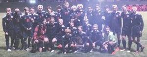 The Grand Blanc soccer team celebrates its Div. 1 district title last Thursday. Photo provided