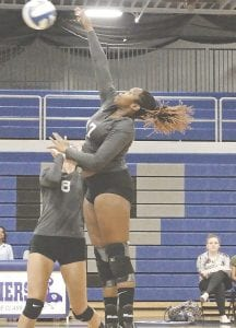Carman-Ainsworth's Sydney Johnson rises up for a spike against Davison on Tuesday. Photo by Terry Lyons