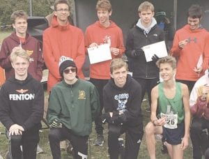 Carman-Ainsworth's Jack Carter, bottom row, third from left, was the lone state qualifier for the Cavs at last Saturday's regional meet. Photo provided