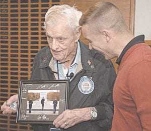 Army Capt. Harold Earls, right, commander of the Tomb Guard, presents World War II veteran Jack Eaton, 100, with a signed photo and challenge coin from the Tomb Guard. The presentation capped Eaton's visit to the Tomb of the Unknown Soldier at Arlington National Cemetery in Arlington, Va., Oct. 23, 2019. Eaton, a former Army corporal, served as a sentinel at the Tomb of the Unknown Soldier from 1938-1940. Army photograph by Staff Sgt. Vanessa N. Atchley