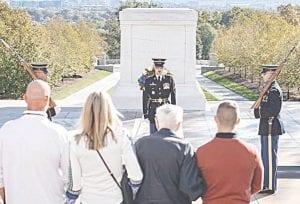 World War II veteran Jack Eaton, his family and Army Capt. Harold Earls, commander of the Tomb Guard, watch the Changing of the Guard Ceremony at the Tomb of the Unknown Soldier at Arlington National Cemetery, Va., Oct. 23, 2019. Eaton, a former Army corporal, served as a sentinel at the Tomb of the Unknown Soldier from 1938-1940. Army photography by Elizabeth Fraser