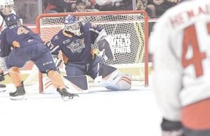 Flint's Luke Cavallin makes a save during a battle with the Windsor Spitfires. Photo by Todd Boone