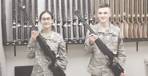 Savannah Belling, left, 15, of Goodrich, and Connor Kendrick, 15, also of Goodrich, are part of the marksmanship team at the JROTC program. Photos by Gary Gould