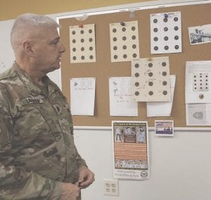 LTC Curt Lapham shows targets from the rifle range.