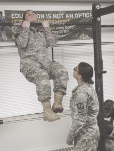 Cadets demonstrate the equipment in the JROTC fitness room.