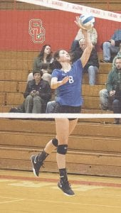 Carman-Ainsworth's Emily Carroll slams a ball against Swartz Creek in last Wednesday's district semifinals at Swartz Creek. Photo by Christina Dominick