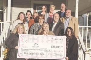 View Newspaper Group is dedicated to giving back. Pictured here is one of five checks donations the company did this year thanks to funds raised at their signature events. Photo by Alex Petrie