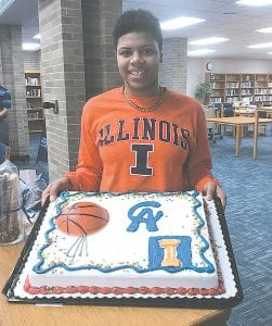 Aaliyah McQueen, a senior at Carman-Ainsworth, was set to enjoy a little icing on the cake after signing her national letter-of-intent to play college basketball at the University of Illinois last Wednesday at the high school. Photo courtesy Carman-Ainsworth athletics