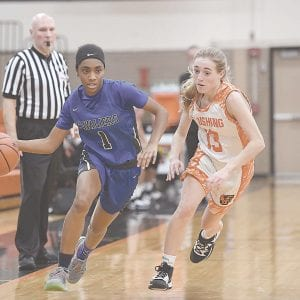 Carman-Ainsworth's Jessiana Aaron drives down the court against Flushing on Friday. Photo by Todd Boone