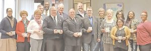 Representatives from 10 local agencies were on hand to receive bus passes from the MTA and the United Way. Photo provided