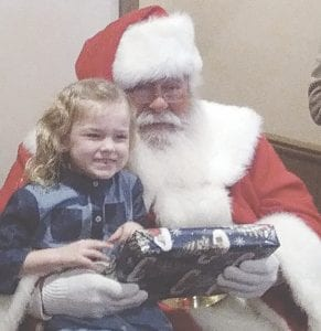 Youngsters from the Michigan School for the Deaf were treated to a special breakfast with Santa compliments of the West Flint Optimist Club. Photos by Lania Rocha