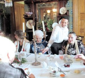 Josh Goldberg serves scones to, from left, Jean McNee of Flint, Cheryl Gregory of Otisville, Patti Skogen of Clio and Anna Cannon of Flushing during the Victorian Christmas Tea Saturday at the Whaley House Museum, 624 E. Kearsley St. in Flint. The Whaley House was decorated for the holidays, and three rooms were dedicated to the tea party. A New Year's tea party is planned for Jan. 18 and a Valentine's Day tea on Feb. 15.