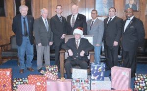 Members of the Flushing Masonic Lodge Chapter #223 posing with gifts. Photo by Ben Gagnon