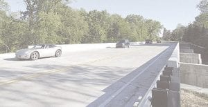 Motorists driving over the new, $1.8 million Mill Road Bridge between Beecher Road and Flushing Road in Flint Township after it reopened in June. File photos