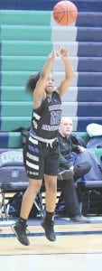 Carman-Ainsworth's Chenelle King launches a three against Lapeer on Jan. 13. Photo by Kylee Richardson