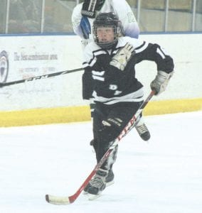The Pride's Anthony Seitz (16) skates the puck against Lapeer on December 4. Photo by Brandon Pope