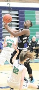 Carman-Ainsworth's DeDe Smith forces her way to the basket against Lapeer on Jan. 13. Photo by Kylee Richardson