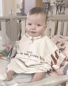 Twenty-one-month-old Emma Mae Withey was born with a condition known as tetralogy of Fallot, which causes holes in heart that affect blood flow and oxygen levels. Emma is undergoing her second open-heart surgery in Ann Arbor today. Photos provided by Angela Withey