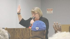 Jean Johnson, president of the Genesee County Senior Citizens Centers Board of Directors, leads the Senior Winter Games Pledge during the Opening Ceremony, Feb. 3 at the Davison Area Senior Citizens Center. Photo by Gary Gould