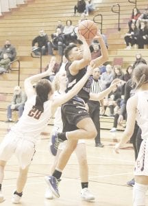 Carman-Ainsworth's Aaliyah McQueen goes up for a contested shot against Davison on Tuesday. Photo by Kylee Richardson
