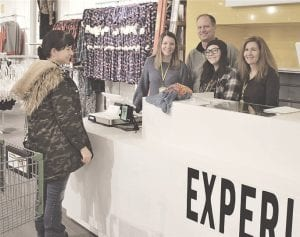 Katherine Stump of Fenton was scooping up the deals at an early shopping VIP event last week just before the new Community Threads store opened in the mall. Photos by Paula K. Schmidt
