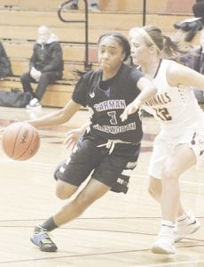 Carman-Ainsworth's Jessiana Aaron drives to the basket against Davison on Feb. 4. Photo by Kylee Richardson