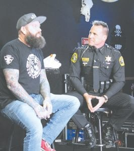 From left, Kevin Zink, owner of the Machine Shop Concert Lounge, 3539 Dort Hwy., Flint, chats with Interim Genesee County Sheriff Chris Swanson. Photos by Gary Gould