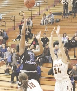 Carman-Ainsworth's Arie Lewis launches a contested shot against Davison on Feb. 4. Photo by Kylee Richardson