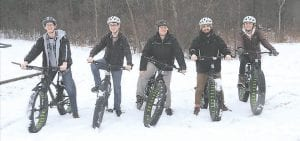 YMCA Camp Copneconic staff members test out the new fat tire bikes, which were purchased as part of a grant from the Community Foundation of Greater Flint. Photo provided