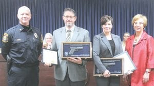 From left, Flint Township Police Chief Kevin Salter, James Daly, Janelle Stokes and Township Supervisor Karyn Miller. Photo by Gary Gould