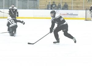 The Pride's Chris Ciak skates the puck across center ice. Photo by Brandon Pope