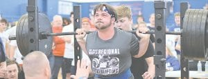 North Branch's Drew Ragatz lifts the weights off the stand at a recent meet. Photos courtesy North Branch Powerlifting