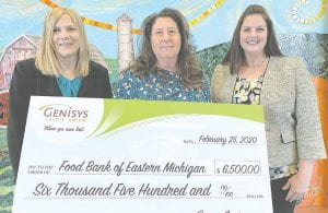 From left, Heidi Wood, Regional Manager at Genisys Credit Union, Kara-Lyn Ross President & CEO of Food Bank of Eastern Michigan, and Heather Pizzala, Vice President of Marketing at Genisys Credit Union. Photo provided