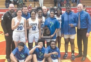 The Carman-Ainsworth girls' basketball team celebrates winning the Div. 1 district title after beating Saginaw Heritage on Friday. Photo provided