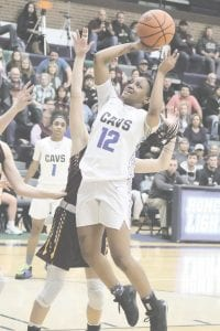 Carman-Ainsworth's Chenelle King launches a lay-up against Davison in Tuesday's Div. 1 regional semifinal at Lapeer. Photo by Kylee Richardson