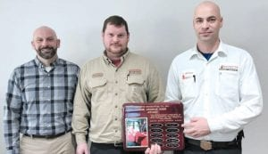 Right: Goyette Mechanical Technician Brandon Moore (center) is presented with the 2019 George Hier Award for Professionalism in HVAC Installation. Presenting the award are Goyette Mechanical General Manager Leif Johnson (left) and Service Supervisor Adam Niestuchowski (right).