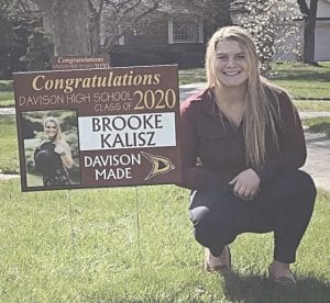 Brooke Kalisz, daughter of Davison resident Stacey Manzardo, with her sign. Photo provided