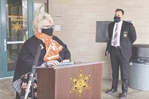 Michelle Rosynsky, CEO of the YWCA of Greater Flint, speaks at a recent media briefing by Interim Genesee County Sheriff Chris Swanson, right. Photo taken from GCSD video