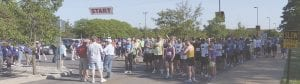 Runners and walkers line up for a past Healing Hands 5k. Because of COVID-19 this year's event, which benefits the Genesee County Free Medical Clinic, will be virtual. File photo
