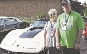"Bob and Sue Gerds, of Millington, posed for a photo in front of their 1978 Corvette before heading out on the 2018 ""Mighty Mac and Back"" Promo Tour. This summer's tour has been moved to fall due to the COVID-19 pandemic. File photo"